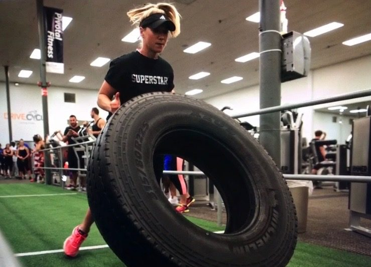 Therapist Kasia Tire Flipping in a CrossFit Competition